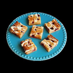 Blondie Raspberry White Chocolate Brownie - De lekkerste blondies nu volledig biologisch! Gemakkelijk per post, voor 14.00 besteld is zelfde werkdag verzonden! Maak kennis met de overheerlijke brownies van EKOBITES | All Organic | Ambachtelijk | Duurzaam | Vers op order | Vegan Keuzes